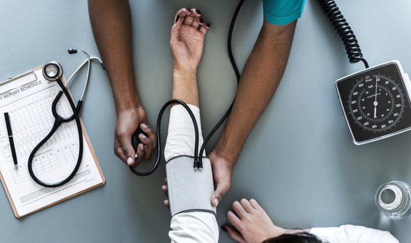 Nurse taking vitals of patient